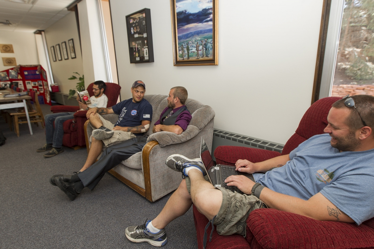 group of student veterans sitting on couches in the lounge