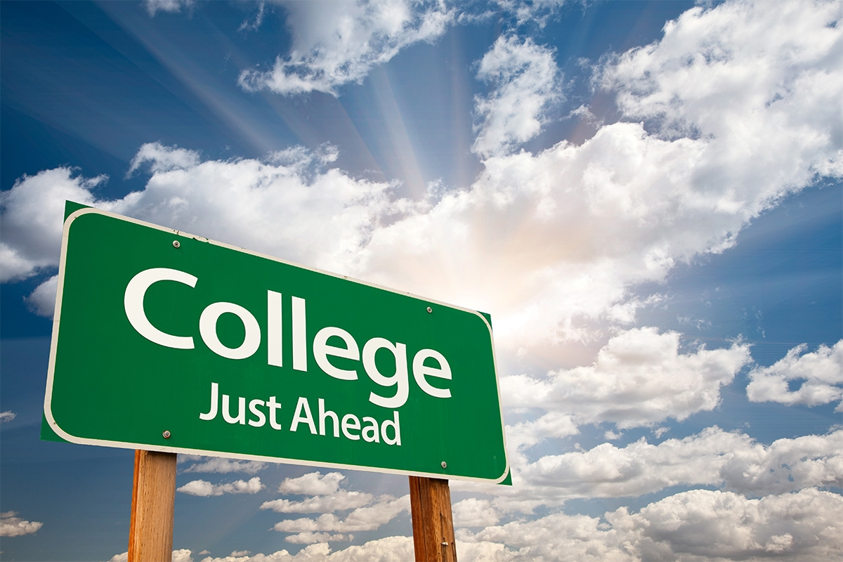 "Photo of sign that says ""College just ahead."""