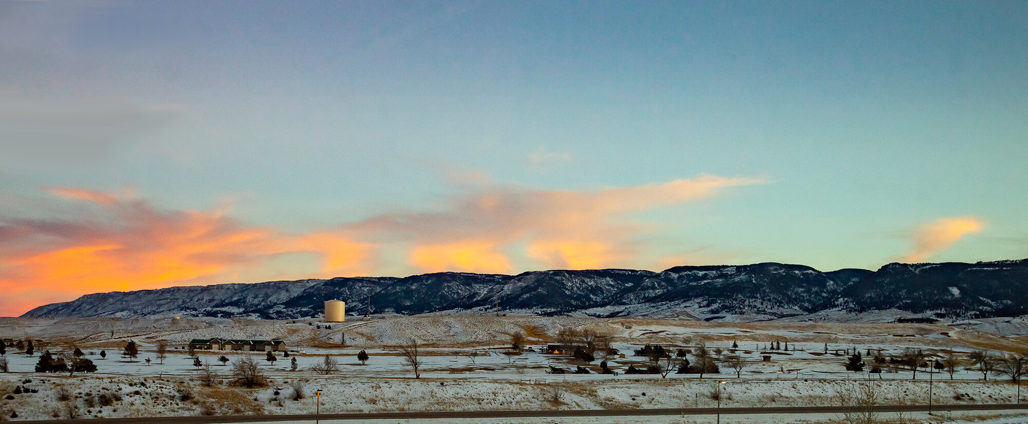 Casper Mountain at sunrise with a light dusting of snow on the ground.