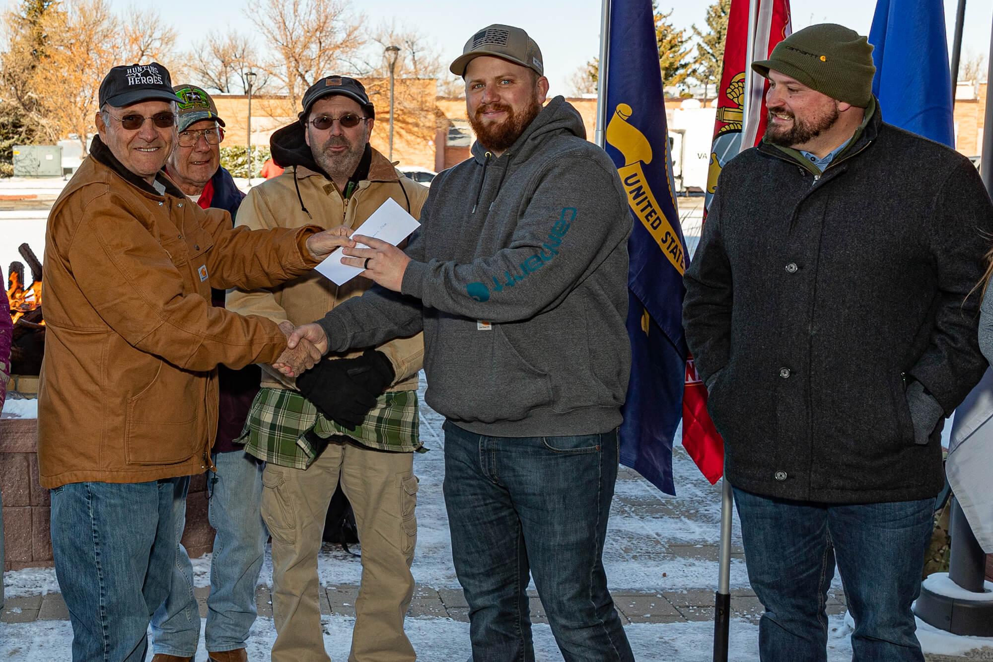 Photo of Casper College Veterans Club receiving a donation check.