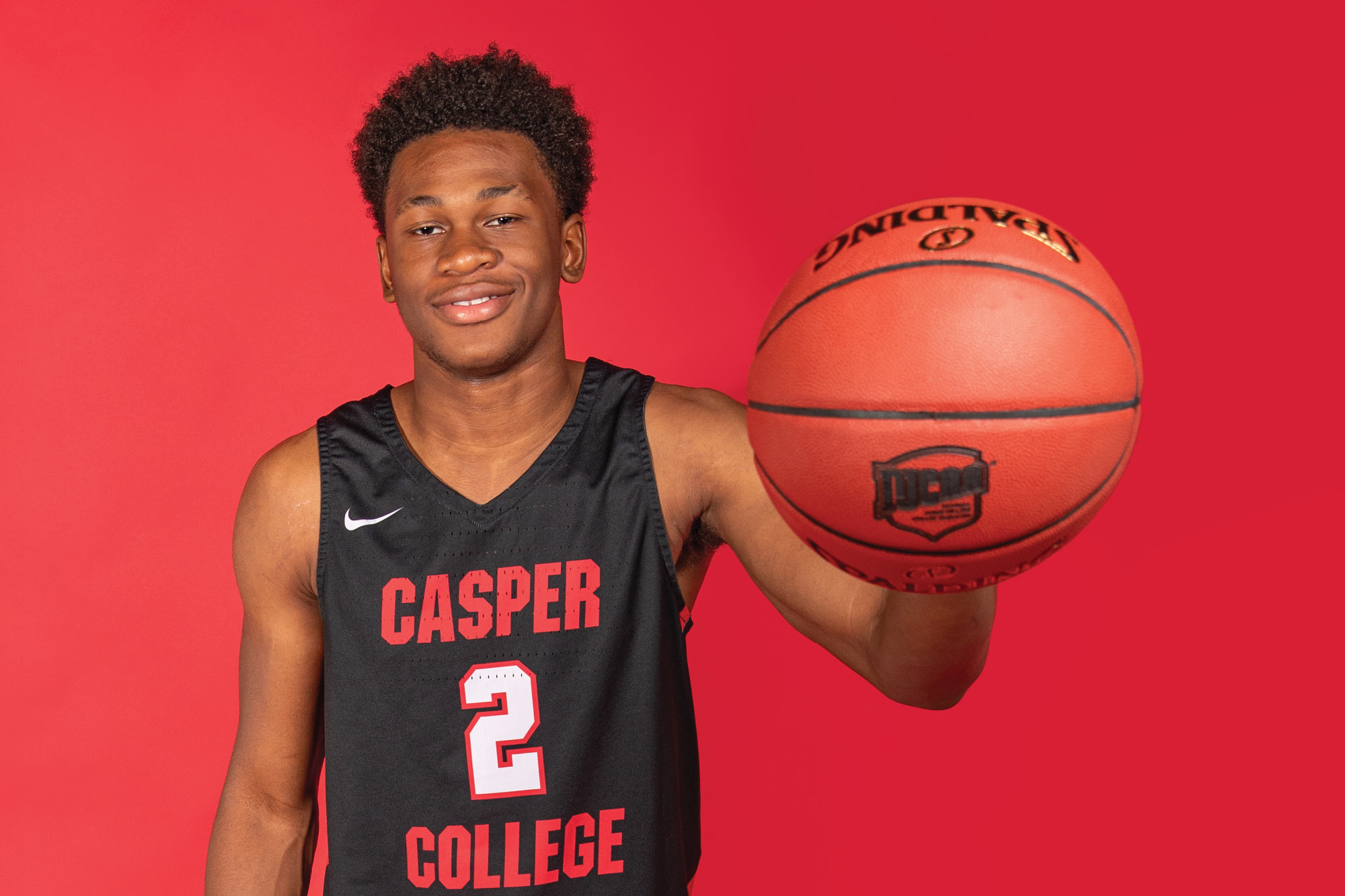 Photo of Casper College basketball player David Walker holding a basketball.