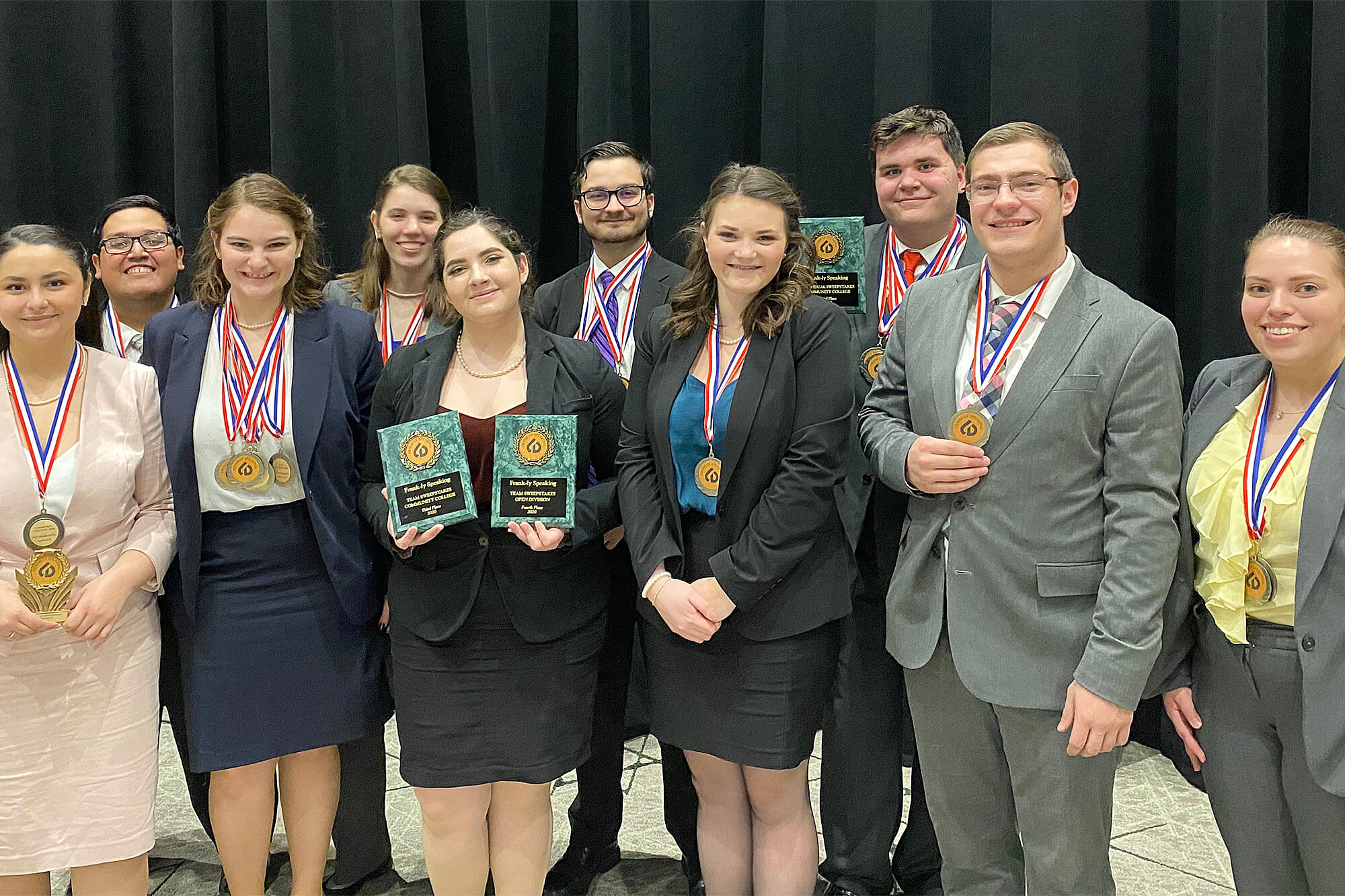 Photograph of debate teams with awards from DuPage College debate tournament.