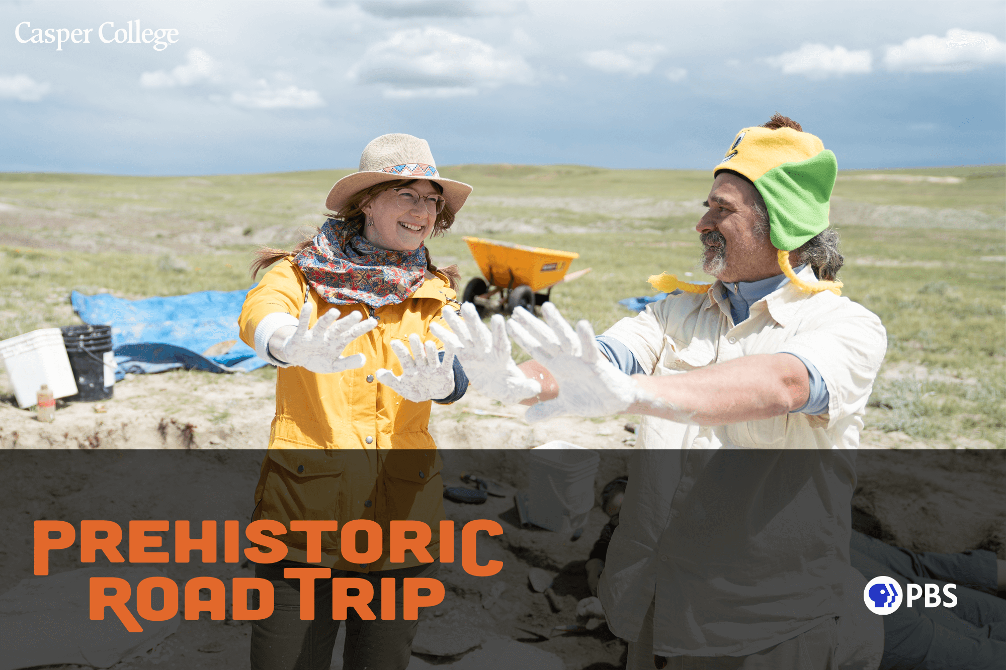 """Photograph of two people at a dinosaur dig site with the words """"Prehistoric Road Trip."""""""