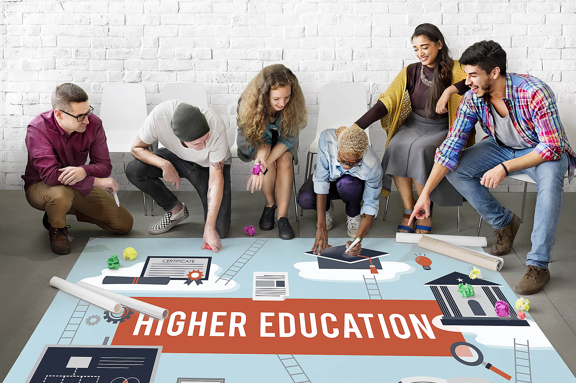 Photo of a group of students looking at a plan for higher education.