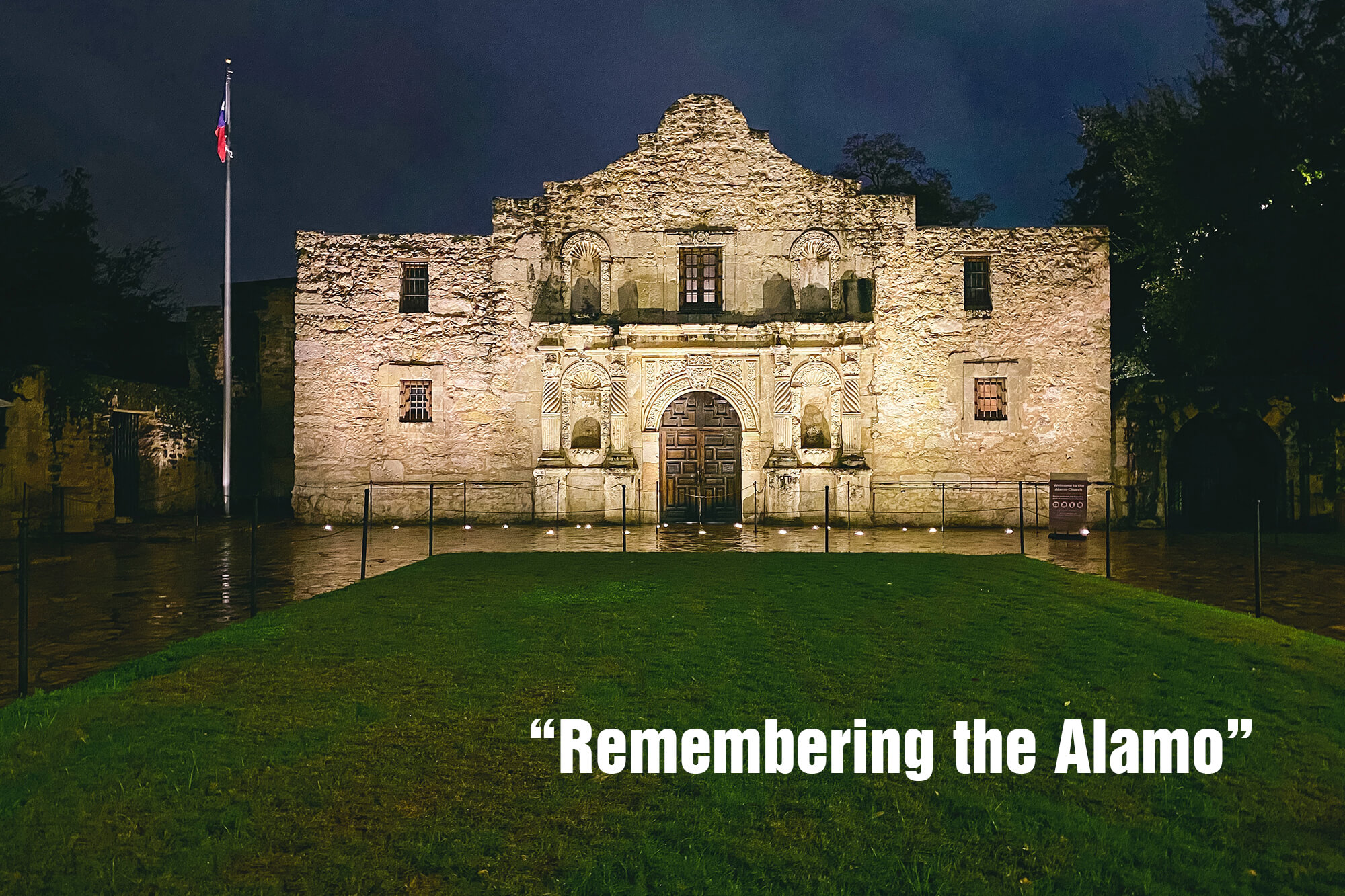 """Photo of the Alamo at night with the words: """"Remembering the Alamo."""""""