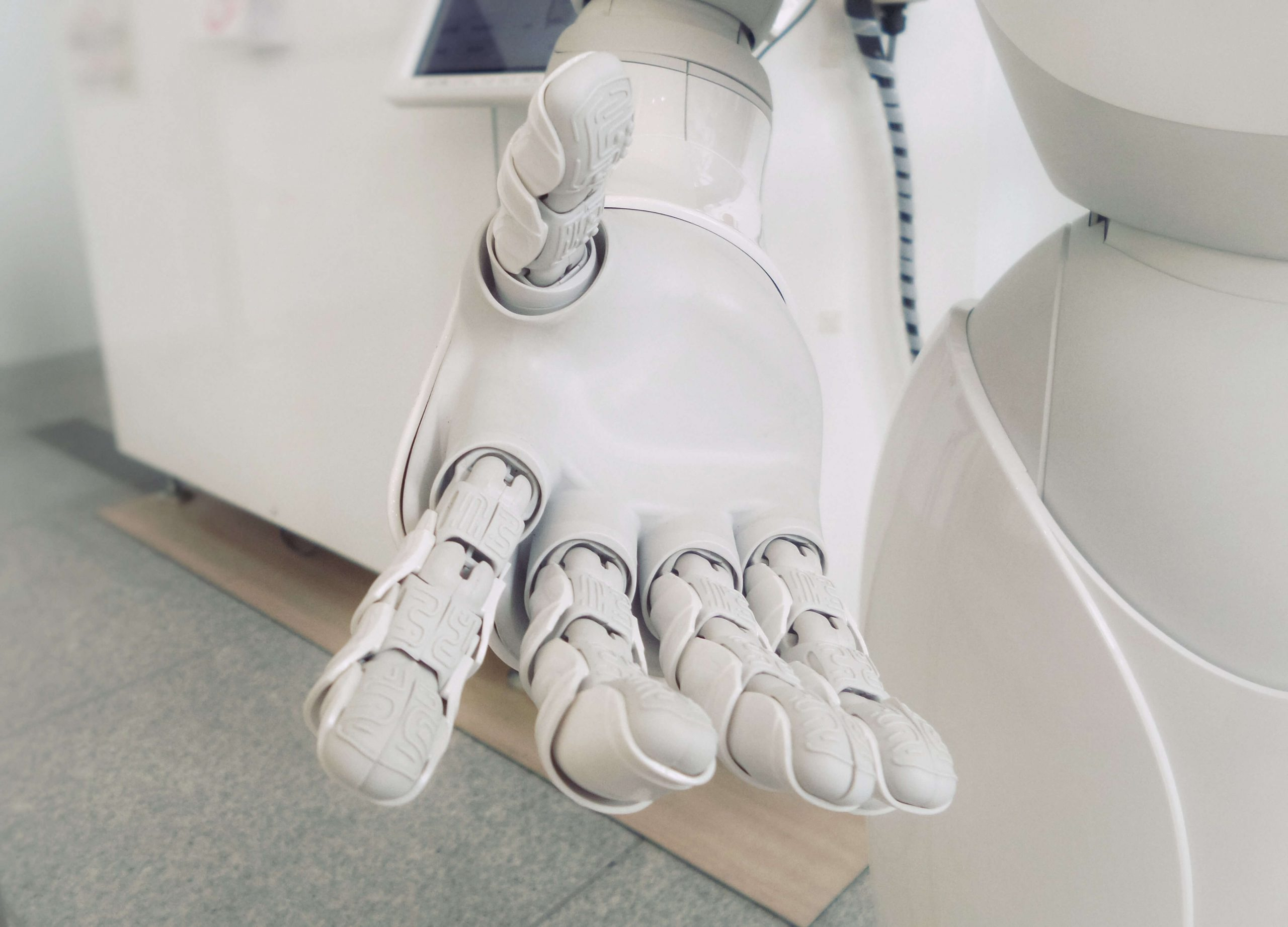 Close-up image of a white robotic hand.