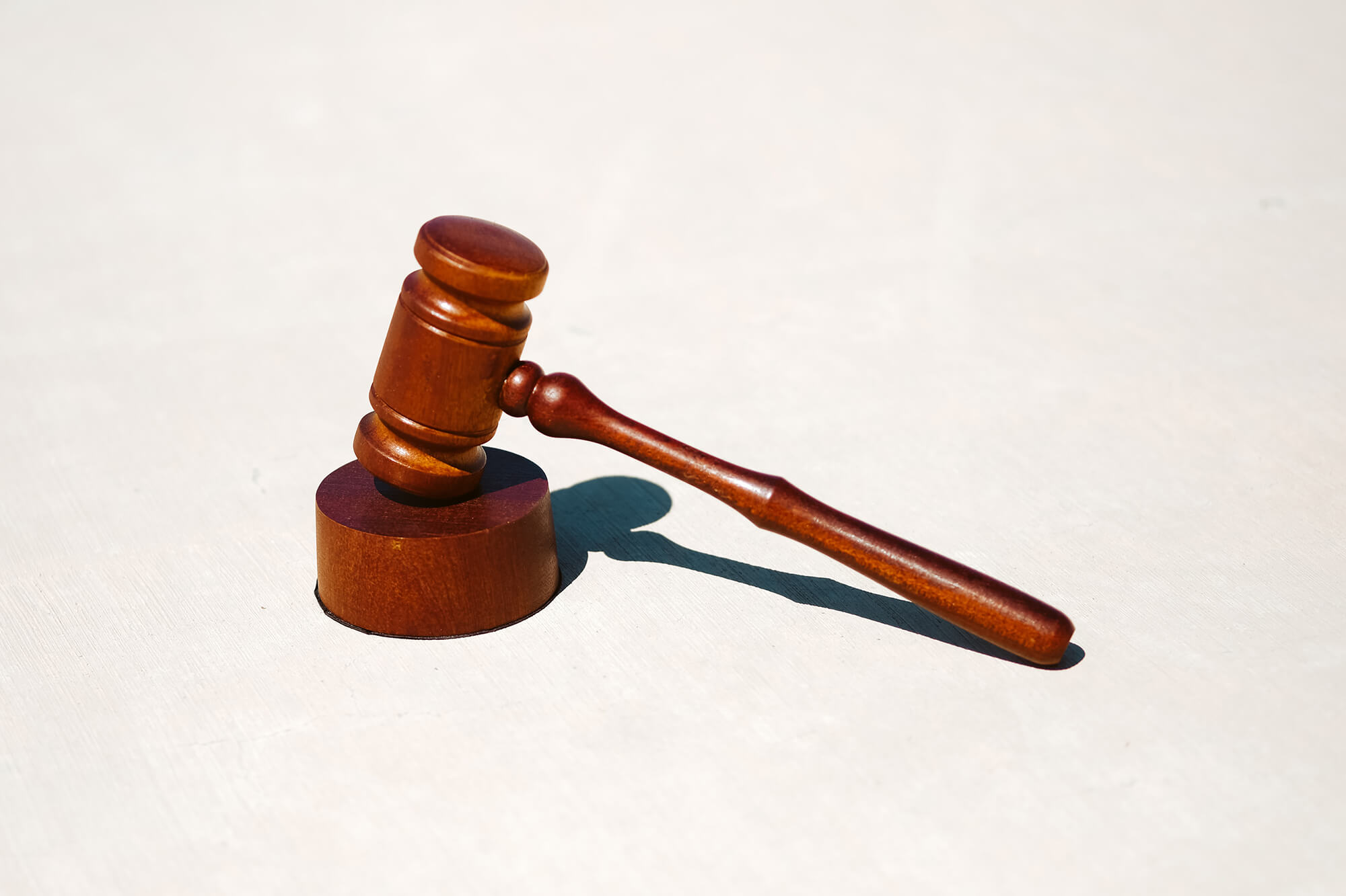 A photo of a wood gavel against a white background.