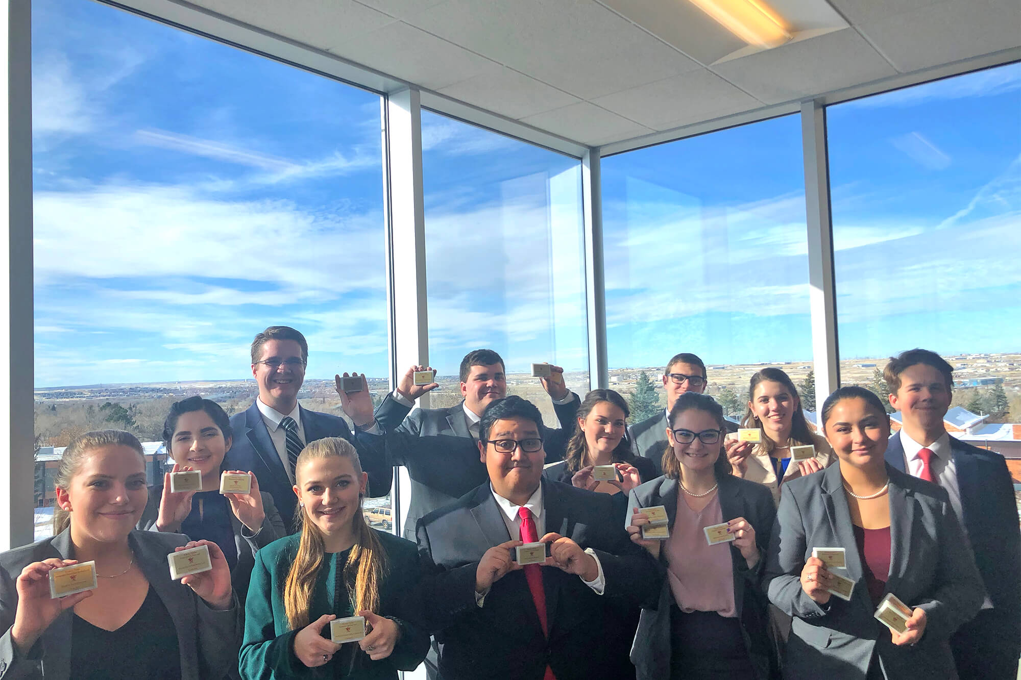 Photo of the Casper College Forensics team holding their awards from the Pioneer Trails Forensics Tournament.