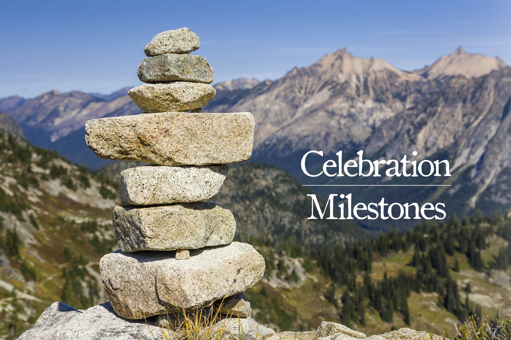 "Photo of a stack of boulders with a mountain in the background with the words ""Celebration Milestones."""