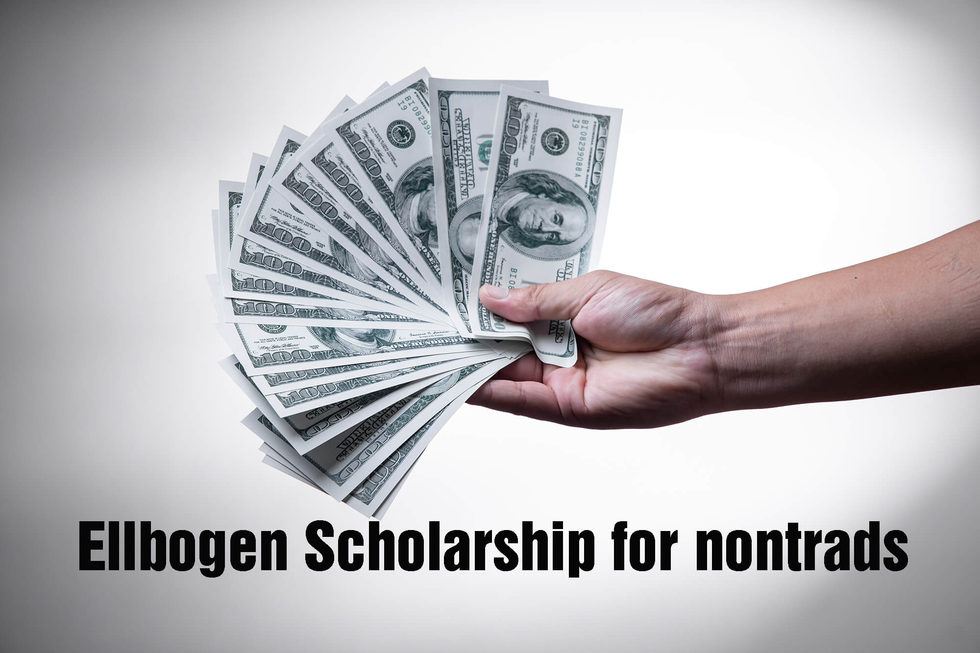 Photo of money in a person's had for the Ellbogen Scholarship press release